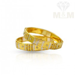 Pleasing Gold Fancy Bangles