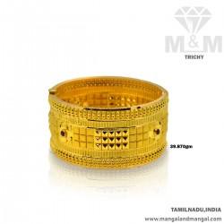 Preeminent Gold Broad Bangle