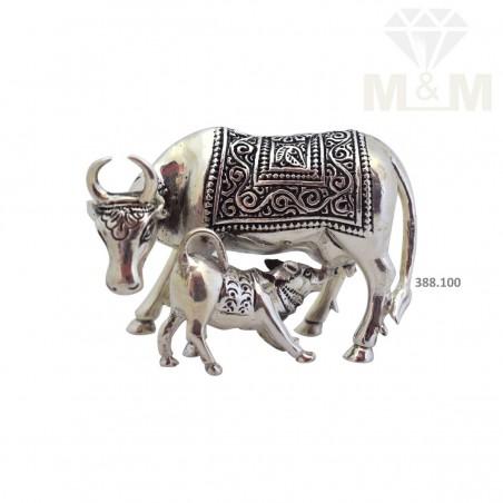 Delightful Silver Antique Cow Idol
